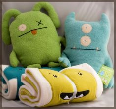 image of two baby blankets and two baby toys