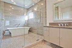 modern bath, slab walls in shower, tub in shower enclosure