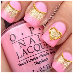 Bubble gum pink nails with gold glitter polish, gold caviar stripe on the moon line, accent nail with caviar outlined gold glitter heart, free hand nail art