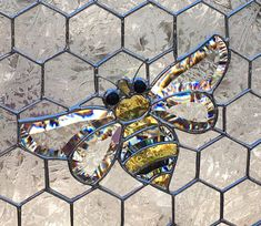 This handmade stained glass panel contains a beveled bumblebee amidst a glass honeycomb pattern, made using the Tiffany copper foil method. Stained Glass Projects, Stained Glass Patterns, Stained Glass Art, Stained Glass Windows, Mosaic Glass, Fused Glass, Mosaic Patterns, Modern Stained Glass Panels, Bee Art