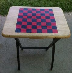 TV Tray Game Board Combo:  I drew a checker board on this wood tray. I then painted in the squares. My last step was to spray on a sealant. Or use Mod Podge. I also painted the legs. So this tray can be used to eat dinner on or to play checkers. For homemade checker pieces find a branch the diameter of a real checker piece. Cut them to size and paint. If you have a set of 4 trays you could make each one a different game. I have a Chinese checkers board I'm working on now.