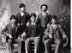 The Wild Bunch in 1900 in Fort Worth TX, in their Sunday best. Legend is they sent this to the Pinkerton Detective Agency. The Sundance Kid, seated, far left, and Butch Cassidy, seated, far right. Donated by the Pinkerton Agency in 1982.