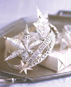 An unusual gift. Elegant tiara says happy birthday in french. Handcrafted of sheet music stars
