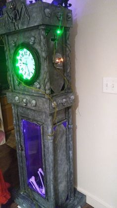 DIY: My Halloween Grandfather Clock. Made From Free Cardboard Boxes From Walmart, White Foam Board, A $5.00 Clock, Empty Christmas Wrap Tubes, Dollar Store Halloween Decorations, A Skeleton From Last Halloween, Some Craft Paint And A Lot Of Hot Glue! Total Cost $25.00 #indoorhalloweendecorations