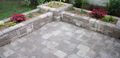 Stone planter boxes for along sidewalk up to house