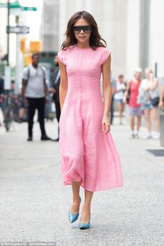 Victoria Beckham adds a splash of colour to NYC in vibrant pink dress while husband David in Tokyo - June 2018