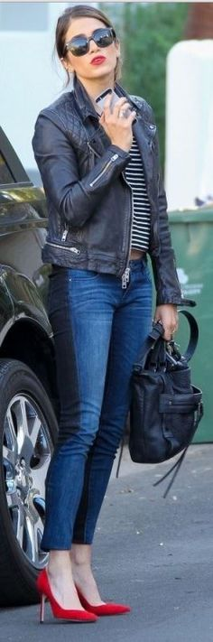 Who made Nikki Reed's black handbag and two tone blue skinny jeans