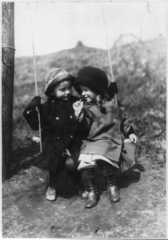 Antique Photo of two girls on a outdoor swing. c1913.