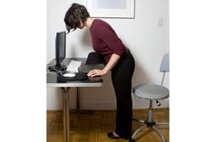 7 Great Yoga Stretches You Can Do at Your Desk: Standing Pigeon