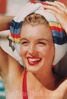 1946 Norma Jean by Richard C. Miller. The Stripe Swimsuit Sitting