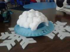 """Winter - """"Ii"""" for igloo Cut styrofoam cup in half.  Cut a small opening in bowl large enough to insert cup half.  Tape cup to bowl and glue cotton balls, starting with the  bottom row.  Takes about 50 balls for each igloo."""