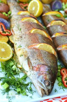 Whole Baked Trout stuffed with fresh herbs and lemon, drizzled with olive oil and baked in a hot oven so it's crisp on the outside and moist inside. This is one of the easiest recipes in the world, but tastes great! The flavors Trout Recipes Oven, Whole Trout Recipes, Rainbow Trout Recipes, Baked Whole Rainbow Trout Recipe, Cooking Rainbow Trout, Fish Dishes, Seafood Dishes, Fish And Seafood, Seafood Recipes