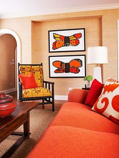 Terra Cotta and Gold  Children's paintings of black-and-orange monarch butterflies inspired the color scheme in this warm living room. Framed in black, they're elevated to the level of fine art on a pale wall that provides a soothing backdrop to the vivid color. Revved-up orange, red, and yellow solids and patterns layer for a fabulous combination that exudes energy. Additional black accents, such as the chair frame, ground the palette and keep the combination of colors from becoming…