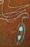 super long silver plate chain with biggo silver feather with turquoise enamel inlay. we are lovin' this retro styled pendant!...