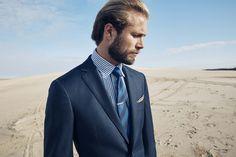 Durand navy suit; Keln navy shirt; Aprica marine tie; Edson tie clip; Wolfgang orange pocketchief.