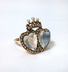Double moonstone heart ring with seed pearls, probably English, 1880-90. Photo courtesy The Three Graces