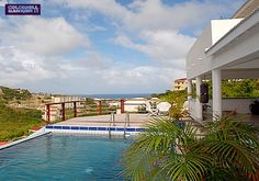 New villa in gated neighborhood. Hillside and ocean views from private pool.  Hurricane protection.