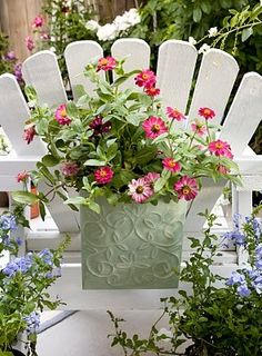 Planter hanging on the back of a Adirondack chair...what a great idea
