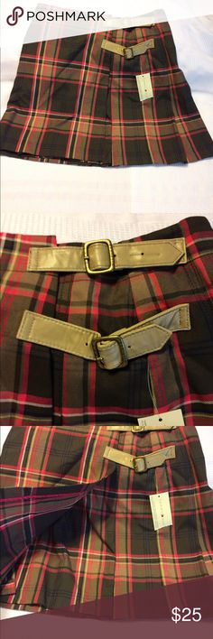 Tommy Hilfiger pleated skirt size 2. Tommy Hilfiger skirt size 2 in beautiful contrasting colors green, pink, yellow to name a few pleats all around two faux leather belts accompanying a button and hood closure a great skirt brand new with tags never worn! Tommy Hilfiger Skirts