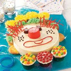 Happy Clown Cake Recipe -Children will find this colorful cake irresistible! It's a snap to put together when you use a cake mix to bake one round cake and a dozen cupcakes. To serve, first pass out the cupcakes, then cut up what's left. —Taste of Home Test Kitchen