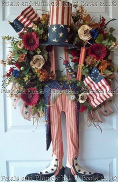 This is too cute but check out the price....  I don't think so!!!  Patriotic July 4th  Wreath Primitive Uncle Sam by PetalsnPlumes, $429.00.  Have to make a Hobby Lobby version...