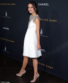 Chanel chic: The 29-year-old actress donned a sleeveless frock embellished with jeweled detailing on the collar and bottom hemline