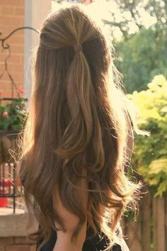 half up holiday party hairstyle