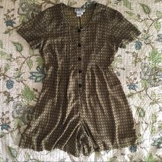 Vintage 90s grunge printed romper Vintage 90s grunge black and gold braid printed romper, buttons down the front. Pleated on the chest, ties in the back. Measurements are taken laying flat armpit to armpit: length: Vintage Dresses Mini