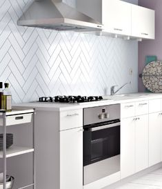 """fishbone tileing"" (Kitchen with HÄRLIG white doors/drawer fronts and FYNDIG white countertop)"