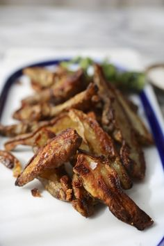 Roasted Sunchokes With Garlic And Herbs (Jerusalem Artichokes). A delicious, healthy alternative to roasted potatoes. I always get these in my CSA and have had a hard time finding recipes...this will be my go to!