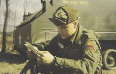 "Elvis Presley reads mail while serving in the Third Armored ""Spearhead"" Division in Germany, circa 1959."