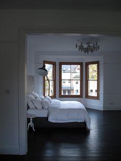 Lamp + dark wood floor