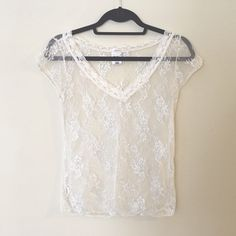 Lace and mesh layering tee This cute mesh and lace top is in great condition! The color is off-white with silver details. There is a stain on the tag, but you can't see it when wearing. Old Navy Tops