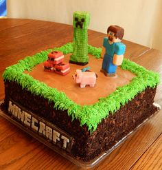 "Nathan's Minecraft cake! 2 layer 10 in square cake, all buttercream and candy clay accents, with crushed oreos, chocolate cookies and cocoa powder ""dirt"" on the side! All edible and no fondant!"