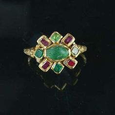 """17th century gold and gem-set """"fede"""" ring, circa 1610. This ring is of particular note as the hands are carved in emerald and for the unusually complex and elaborate way it is constructed, as seen on the reverse. For similar period rings incorporating circular clusters of gemstones on a relatively thin hoop, c.f The Museum of London. Cheapside Hoard, and Chadour. A.B., Rings: The Alice and Louis Koch Collection Leeds, 1994."""