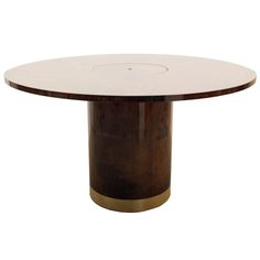 1stdibs - Aldo Tura Parchment Table Round pedestal table by Aldo Tura in lacquered goat skin incorporating a recessed ice bucket / planter made of polychromed aluminum with the matching goat skin cover.