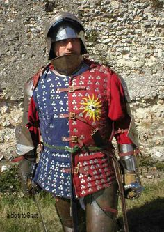 brigandine - consisted of a padded, quilted doublet, the cells of which were filled with iron plates