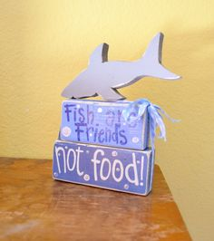 Hey, I found this really awesome Etsy listing at http://www.etsy.com/listing/156395715/shark-finding-nemo-wood-block-shelf
