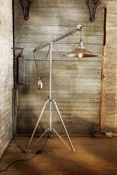 Our Mina floor lamp comes from  century-old traditions. From the high shine of the nickel finish to the intricate gears and cranks, this lamp demonstrates the precise craftsmanship of old bicycle makers. Adjustable legs and a weighted pulley system bring a sense of balance to the retrofitted design. Remarkable, not only for its style, but its one-of-a-kind history.