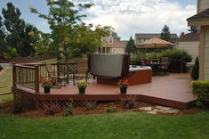 Multi-sided wood deck with hot tub and dining table I could dream about having something like this