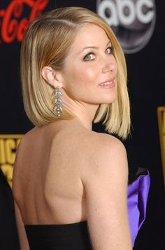 Christina Applegate rocks an A-line bob like no other! Tucking one side behind your ear accents the asymmetry, makes the perfect frame for beautiful jewelry, and highlights the collarbone-one of the sexiest parts if a woman's body!