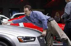 Steve Bielecki of Motor Information Systems measures the hood of the Audi Allroad during the Detroit auto show industry preview. Audi Allroad, Detroit Auto Show, Detroit Free Press, Michigan, Competition