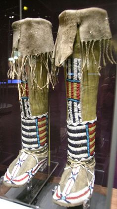 Cheyenne Leggings  Circa 1890. Made of hide, sinew, seed beads, green and yellow paint and rawhide