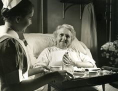 This is a photo from the late 1940s of a Lancaster General Hospital nurse serving a meal to a patient. Service with a smile!