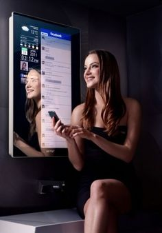 Magic Mirror ~ Cybertecture uses a TV-style remote control. It will show you email, schedules, flight status notifications and even your progress with diet and exercise.