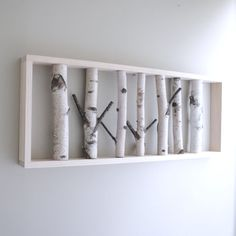 Would make an awesome headboard mounted above a bed. Would be super cool to incorporate undulating shelves for small silver and black pictures with aspen leaf green and yellow wash behind it. Down lighting would be super cool, too. Birch Logs, Birch Branches, Birch Trees, Branch Decor, Rustic Wall Decor, Plywood Headboard, Driftwood Headboard, Birch Forest, Houses