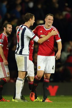 Jonny Evans of West Bromwich Albion greets Phil Jones of Manchester United at the end of the Barclays Premier League match between Manchester United...