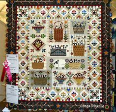 quilt is called Letter Carriers by Janet Stone, Overland Park, KS.  The ribbon is for Exemplary Machine Quilting.