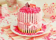 Make a cake look all professional-like by surrounding it with candy sticks.  Kit kat works too.