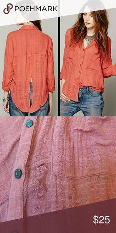 Free People open back, button down! Tear in front near pocket, but otherwise in excellent condition! Free People Tops Button Down Shirts